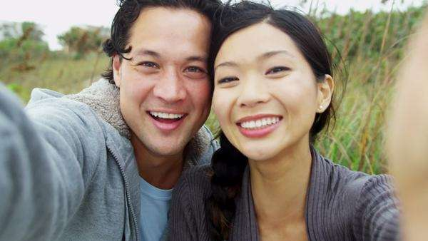Close Up Asian Chinese Young Couple Smiling Filming Selfie Royalty-free stock video