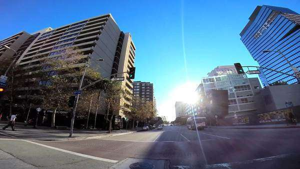 POV drive wide angle sun flare downtown vehicle traffic Los Angeles USA Royalty-free stock video