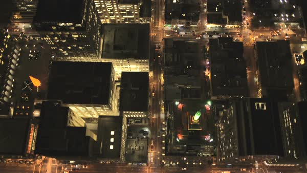 Aerial overhead rooftop city night traffic illuminated city streets skyscrapers commuters San Francisco California USA Royalty-free stock video