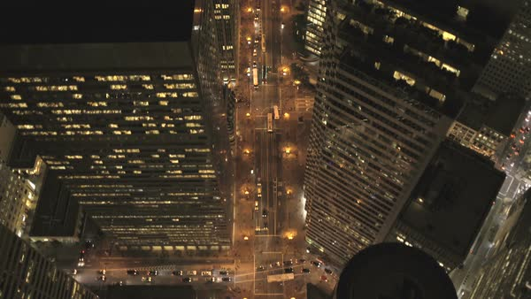 Aerial low level overhead night illuminated rooftop view Downtown Skyscrapers commuter traffic San Francisco California USA Royalty-free stock video