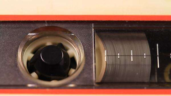 Tape. A macro static camera view of vintage audio cassette tape with a blank white label in use sound recording in a cassette player. Royalty-free stock video