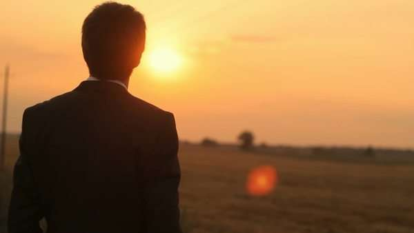 Businessman dreaming about future, sunset Royalty-free stock video
