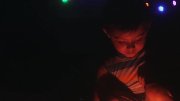 Hand-held shot of a boy holding a sparkler Royalty-free stock video