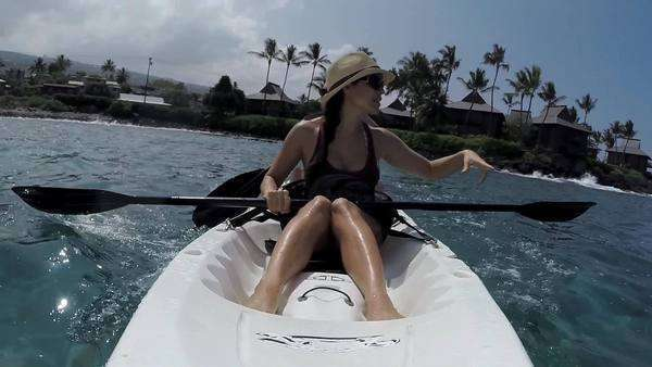 Woman paddling a kayak on a perfect blue Hawaiian day. Royalty-free stock video