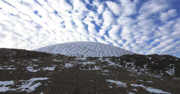 Hiking on Mauna Kea with cool looking snow. Royalty-free stock video