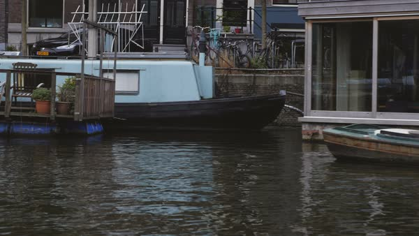 Sailing by houseboats in Amsterdam. Royalty-free stock video