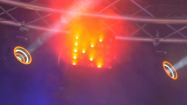 Smoke drifts around spinning LED lights on stage.  Royalty-free stock video