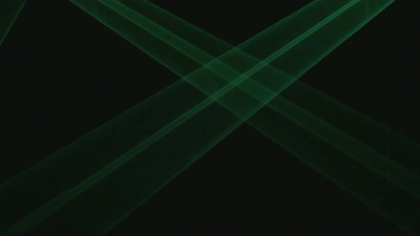 Green laser light beams crossing each other behind a black background.  Royalty-free stock video