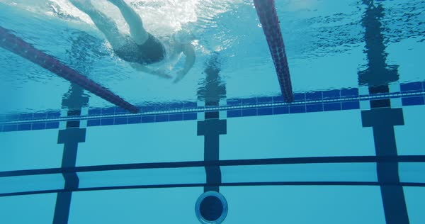 Underwater Long Shot Of A Professional Swimmer Swimming Breaststroke Royalty-free stock video