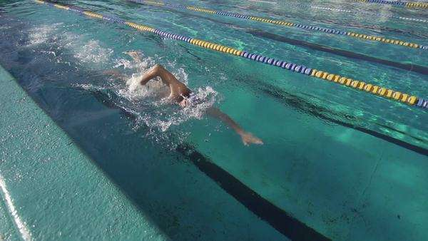 Slow motion of a professional swimmer performing the front crawl stroke in the pool outdoors Royalty-free stock video