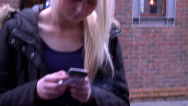Medium shot of girl texting on her cell phone Rights-managed stock video