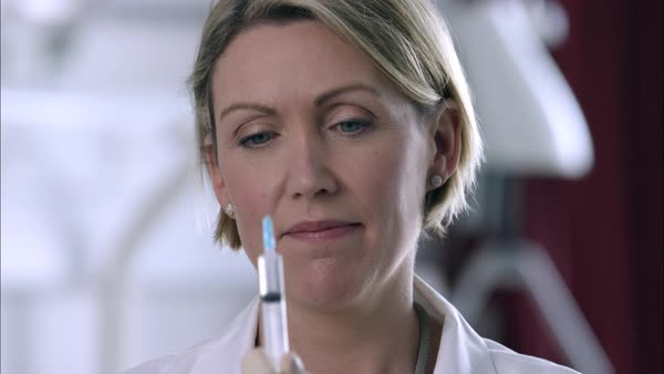 Close up shot of doctor testing a syringe Rights-managed stock video