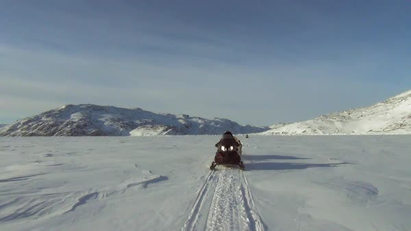 Full shot of a moving electric snow sled Rights-managed stock video