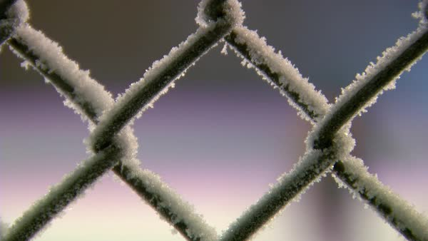 Close-up of a fence covered with snow Rights-managed stock video