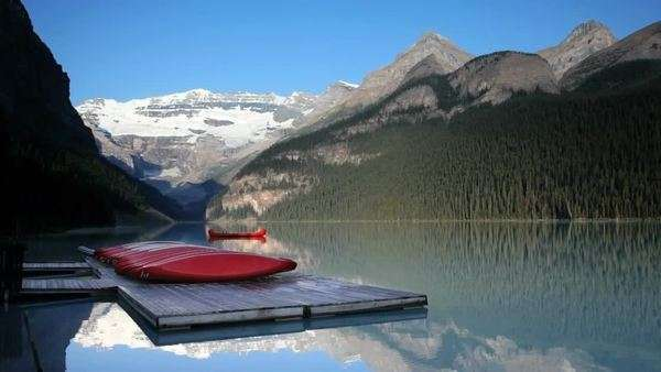 Row of canoes on a dock on Lake Louise, Banff National Park Royalty-free stock video