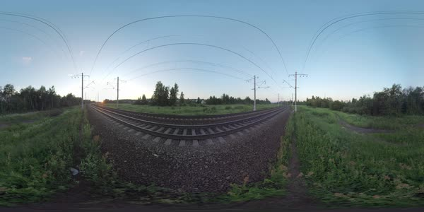360 VR video. Passenger train moving outside the town through green countryside at sunset Royalty-free stock video
