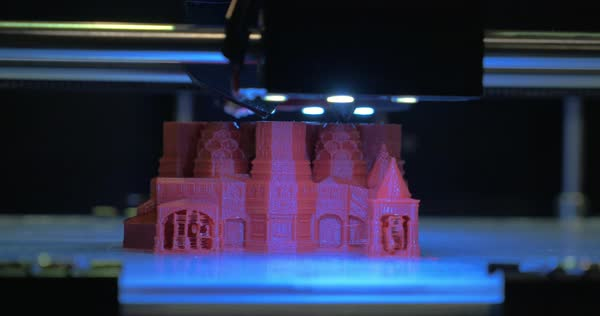 Close-up shot of printing 3D model of St Basil Cathedral in red color Royalty-free stock video