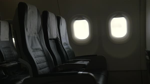 Seen interior decor of plane - black leather chairs and two portholes Royalty-free stock video