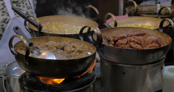 Different dishes in saucepans cooking on gas fire in street restaurant of Chinatown in Bangkok, Thailand Royalty-free stock video