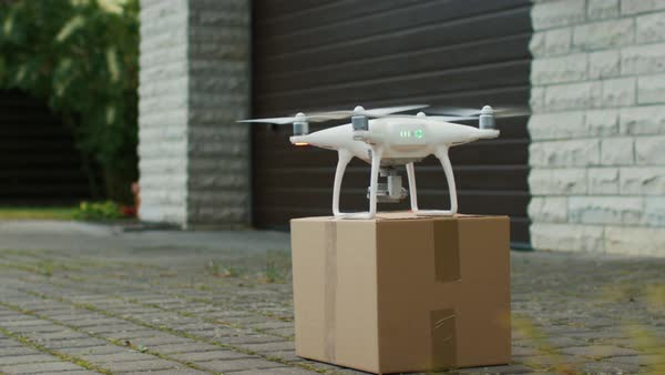 Flying drone delivers postal package right to your porch Royalty-free stock video