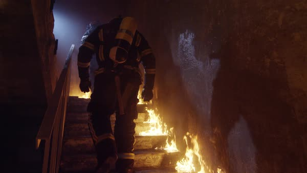 Two strong firefighters going up the stairs in burning building Royalty-free stock video