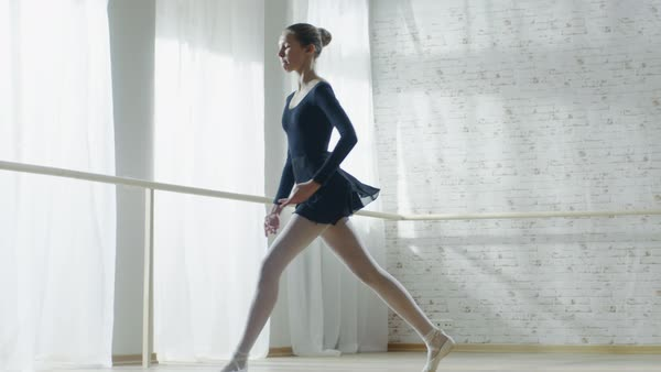 Young and graceful ballerina jumps in slow motion Royalty-free stock video