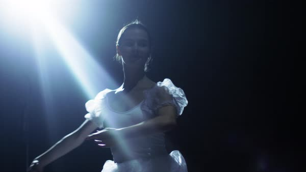 Mid shot of a beautiful young ballerina dancing gracefully in the spotlight Royalty-free stock video