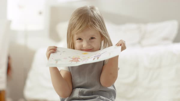 Cute young girl shows her drawing of a family. Royalty-free stock video