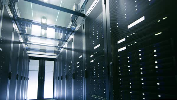 Camera walkthrough shot of a working data center with rows of rack servers. Royalty-free stock video