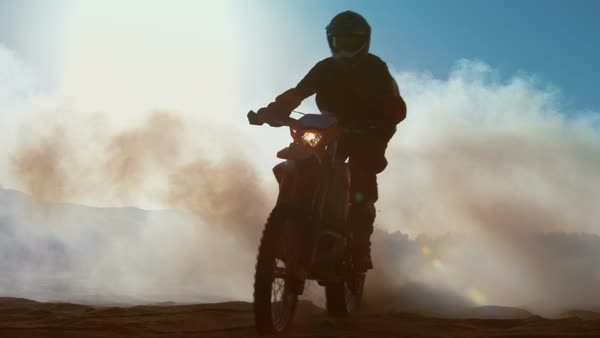 Professional motocross FMX motorcycle rider drives through smoke and mist over the dirt road track Royalty-free stock video