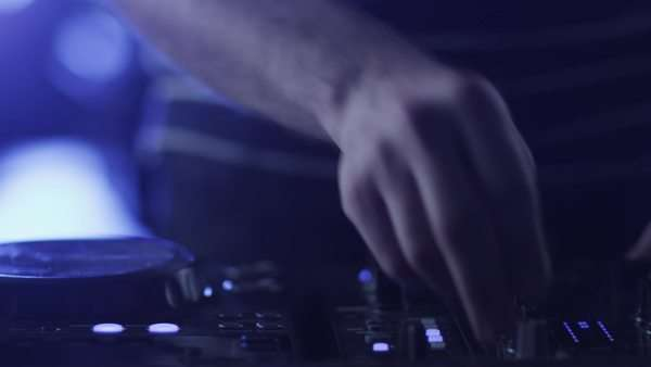 Dj mixing music on console in nightclub Royalty-free stock video