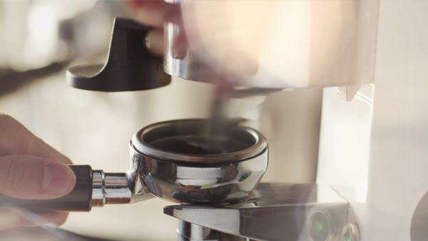 Making ground coffee with coffee grinder. close-up. Royalty-free stock video