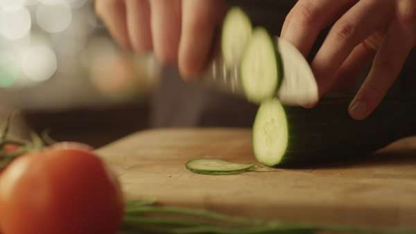 Professional chef is rapidly chopping cucumbers Royalty-free stock video