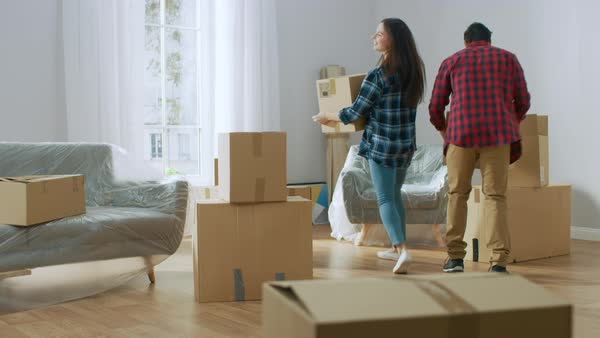 Hy Young Moving Into New Apartment Carrying Cardboard Boxes With Stuff Having Fun