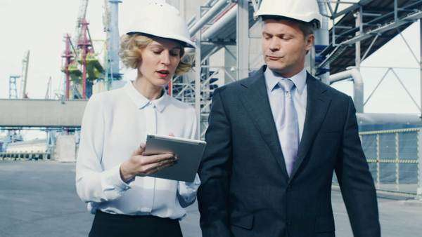 Woman and male managers at cargo harbor. Royalty-free stock video
