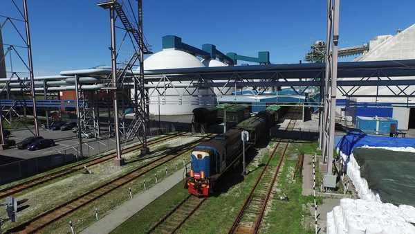 Aerial drone shot of moving freight train in cargo railway station Royalty-free stock video