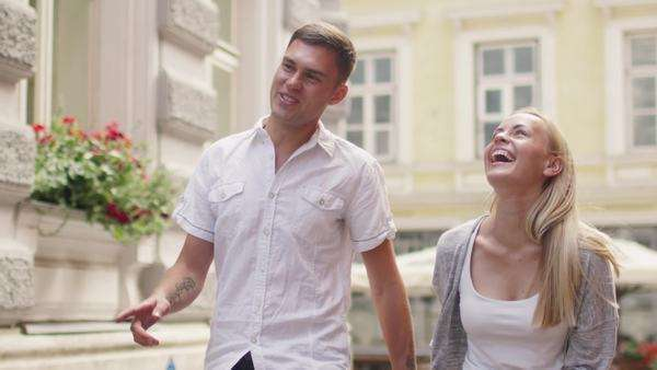 Happy couple is walking together in European town Royalty-free stock video