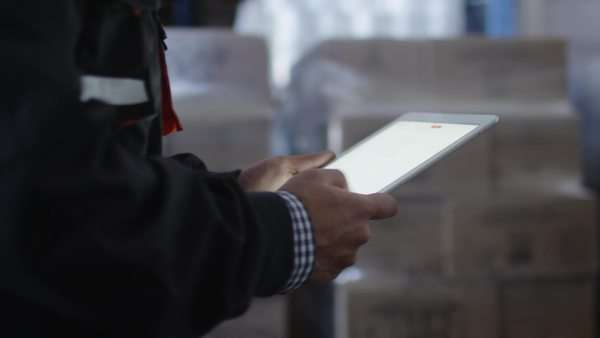 Worker of logistic warehouse is holding tablet in hands. Royalty-free stock video