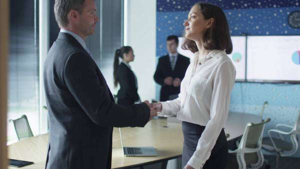 Handshake between male manager and female office worker Royalty-free stock video