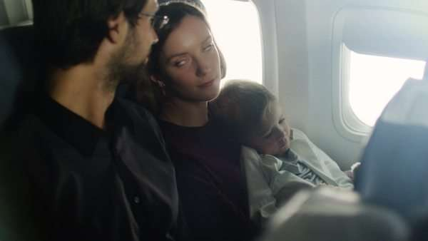 Romantic moment with a family with child on board of a plane next to a window. Royalty-free stock video