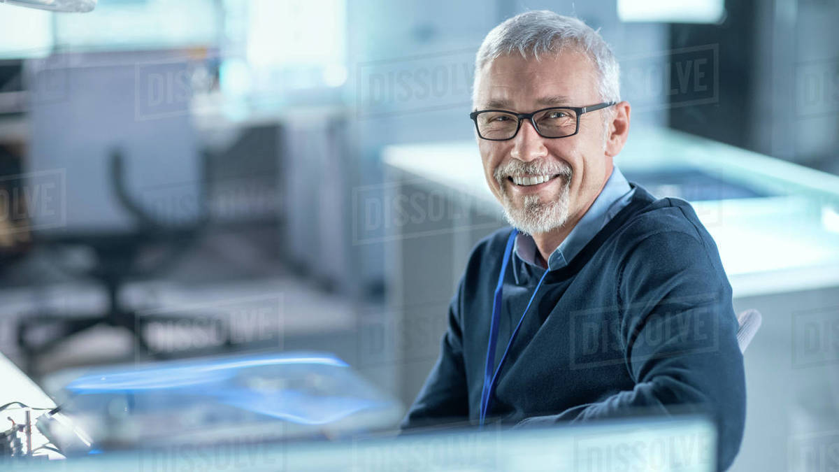 Professional Electronics Design Engineer Wearing Glasses Works in Research Laboratory and Smiles on Camera. Royalty-free stock photo