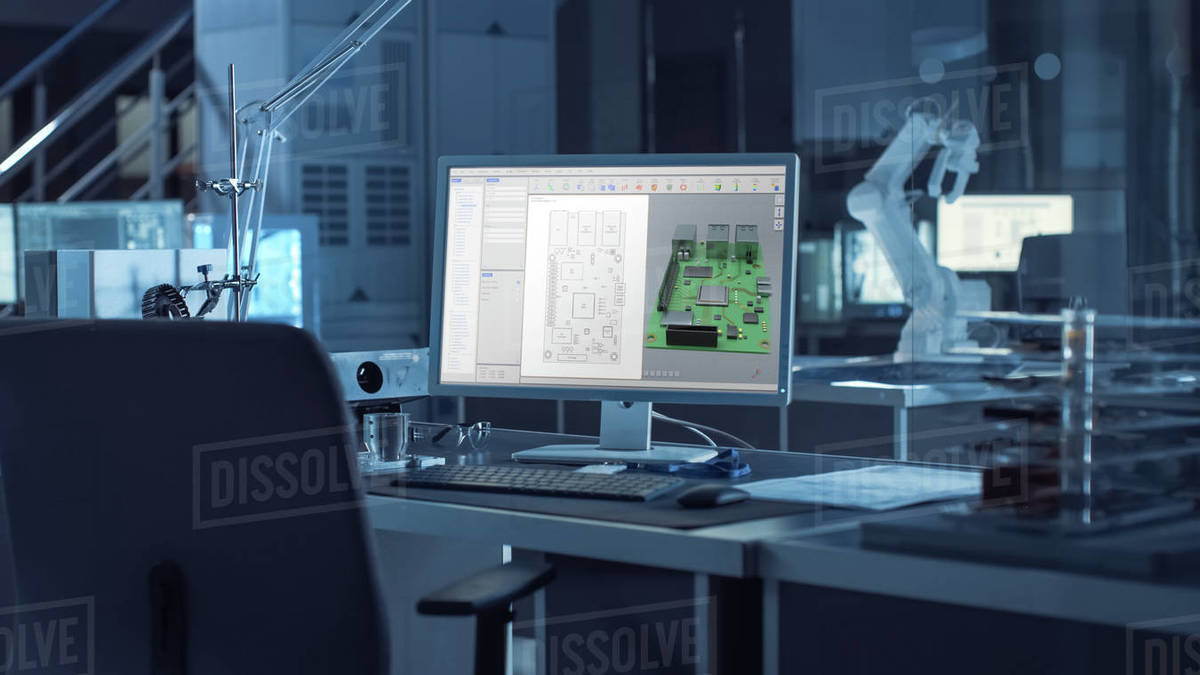 On the Desk Computer With CAD Software and Design of 3D Industrial Machinery Component. In the Background Robot Arm Concept Standing in Heavy Dark. Industry Engineering Facility. Royalty-free stock photo