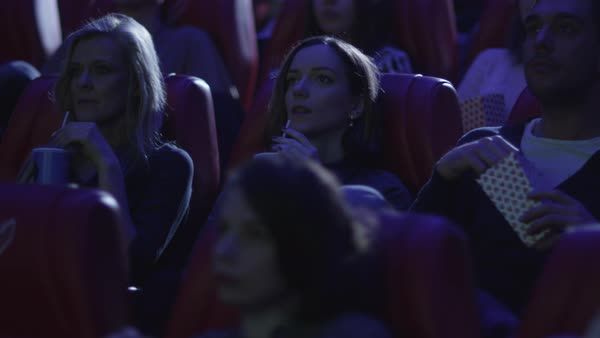 Group of people are watching a film screening in a movie cinema theater. Royalty-free stock video