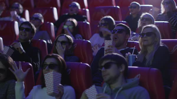 Group of people in 3d glasses are scared while watching a horror film screening in a movie cinema theater. Royalty-free stock video