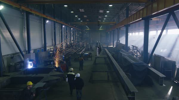 Heavy industry factory with workers and flying sparks. Royalty-free stock video