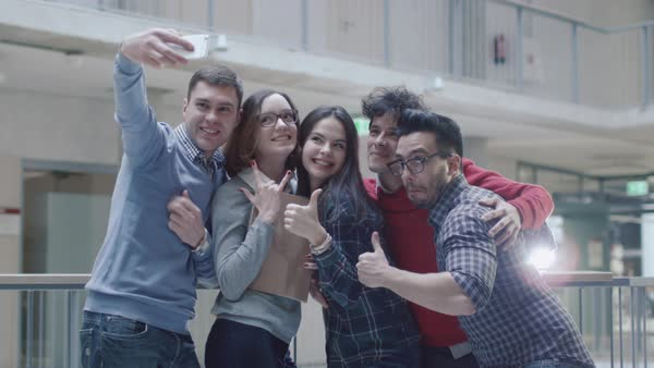 Group of young multi-ethnic students are making selfie photos in an university. Royalty-free stock video