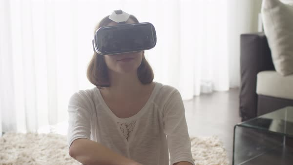 Woman wearing vr headset in living room. Royalty-free stock video