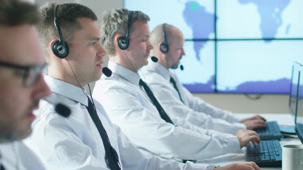 Team of customer support professionals in call center office Royalty-free stock video