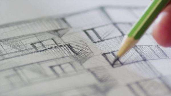 Architect is sketching a building on paper Royalty-free stock video