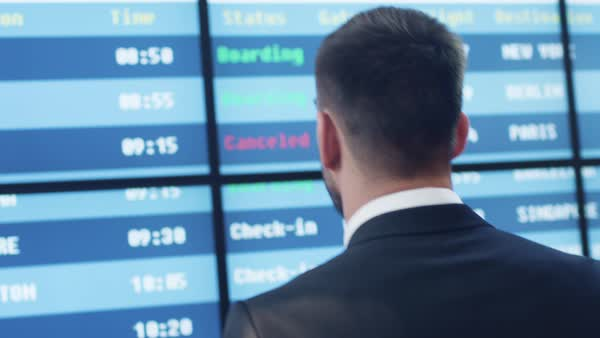 Businessman looking at information board in the airport. Royalty-free stock video